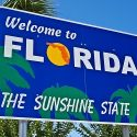 A sign welcoming visitors to Florida, the Sunshine State.