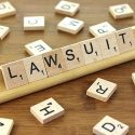 """The word """"Lawsuit"""" spelled out in scrabble letters."""